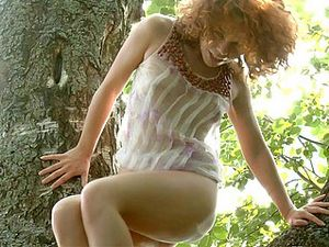 Limber Girl Climbing A Tree And Masturbating Up There