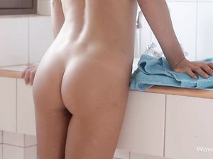 Taut Young Brunette Shaving In The Bathroom